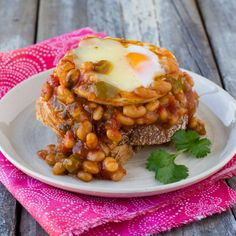 Try this one-pot brunch-in-bed this weekend. Rich in flavour, you'll find the combination of spicy eggs, beans and toast is deliciously filling. Beans On Toast, Brunch Dishes, Coriander, Spicy, Eggs, Breakfast, Board, Recipes, Hair