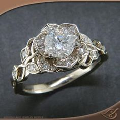 Diamond lotus engagement ring, not....thinking 10 year anniversary gift...I know we'll get there, but will I get it? Lotus Ring, 10 Anniversary Gift Ideas, Anniversary Jewelry, Vintage Anniversary Rings, Sapphire Anniversary, Ruby Rings, Emerald Rings, Diamond Rings, Silver Rings
