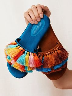 Watercolor Tassel Sandal | Add a bright pop of color to your look with these fun slide-on sandals featuring bold, multi-color tassel details on the top of the foot.    * Flocked rubber sole * Comfortable padded footbed #diysandalstassel
