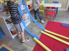 Engineering with ramp making materials in preschool