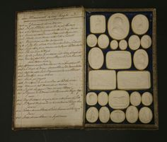 Paoletti, late 18th/early 19th century, four bound volumes of plaster intaglios, together with two wooden cased sets of plaster intaglios by Thomas Cades, Graveur, complete with handwritten index, a tray of red plaster intaglios etc. (qty.) Sold for £1550 on 14th March 2017