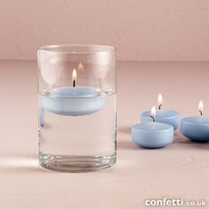 Coloured Floating Candles - Confetti.co.uk