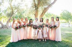 Bridesmaids in romantic pale pink dresses