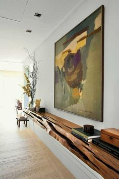 Great natural elements--beautiful wood shelf, tall curly willow large nature painting