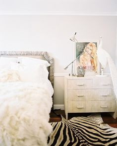 Chic Feminine Bedroom. Love the zebra rug... maybe with some neato wallpaper??