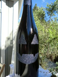 Pumpkin face wine bottle