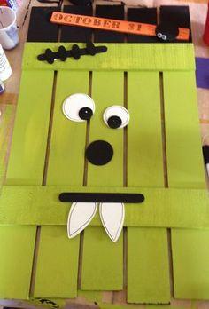DIY Frankenstein door hanging   Halloween project with big popsicle sticks and googly eyes