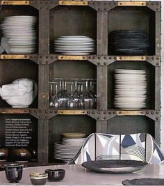 Make a feature out of storing your kitchen crockery with an industrial metal and wood unit like this one