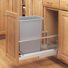 The door-mounted Pull-Out Waste Container by Rev-A-Shelf features brushed aluminum frames and soft closing slides that glide. Door mount hardware finishes the look and allows you to mount your existing cabinet door directly to the waste container. Trash Can Cabinet, Waste Container, Rev A Shelf, Garbage Can, Base Cabinets, Recycling Bins, Kitchen Organization, Kitchen Bins, Kitchen Organizers
