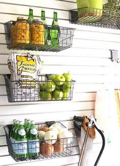 Hanging wire baskets on slat wall. Great in a basement, garage or pantry Diy Kitchen Storage, Pantry Storage, Kitchen Pantry, Garage Storage, Storage Room, Storage Baskets, Food Storage, Shelves In Kitchen, Kitchen Racks