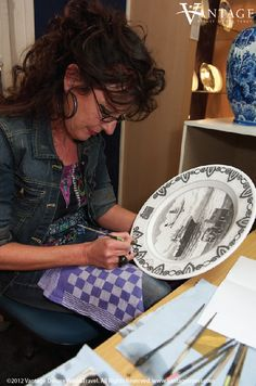 Royal Delft Factory, The Netherlands.  Love the dutch towel that she is using :)