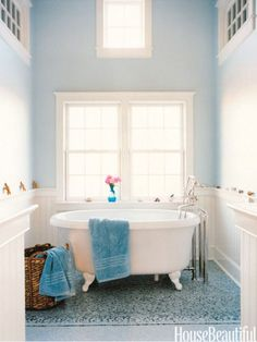 Pure as a Shaker church, this blue master bathroom gets its airy look from high ceilings and walls painted with Farrow & Ball's Borrowed Light. Designer Frank Roop drew the mosaic tile floor on a computer with CAD software, and Tile Showcase manufactured it in one piece, like a carpet. http://www.housebeautiful.com/decorating/colors/spring-decorating-ideas#slide-21
