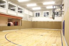 Like the look of this sport court if we did it in the basement -- more earthy than most and not the bright primary colors that others have.