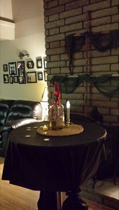Take empty liquor bottles add sand and a message burn a candle on top, makes for a great centerpiece