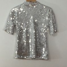 "DVF Silver Sequin Top Size 2 Exquisite Diane Von Furstenberg silver sequin top size 2.   5 hook/eye closure on back (top area).   Shell is 100% Polyester. Cream color lining is 100% Silk.   Approximate measurements:   Bust: 34"" Sleeve: 11"" Length: 24""   In great condition (just had it dry cleaned). Perfect for a night out on the town!  OFFERS WELCOMED!   Thank you.❤️❤️❤️ Diane von Furstenberg Tops"