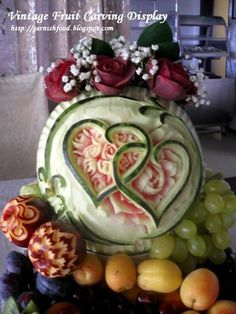 Holy cow!!! Carved from fruit... vintage wedding fruit display.
