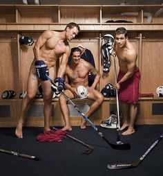 Hockey men are so hot!  Sadly this is not what coed locker rooms look like. The guy in the Middle is Sheldon Souray. The guy on the right is Andrew Cogliano. Both of them play for the Anaheim Ducks! No clue who the guy on the left is? The Ducks have the hottest team in the NHL imo =)