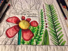 Coloring with pencils on quilted fabric -- explains painting colors with water (bleeds beyond lines on fabric) & fabric medium (sets color only in spot you wet...&no need to heat set w/liquitex or versatex)
