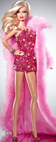 "Pink Diamond™ Barbie® doll is extra special as her stunning fuchsia and rose ""gem"" encrusted mini corset dress and pumps were designed and hand embellished 