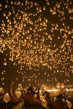 Floating Lantern Festival, Thailand. You write something (a secret, a struggle, a regret, etc…) you've been holding on to for a long time inside one of these so when you release the lantern you have 'let it go'.