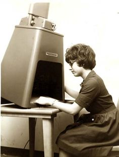 When microfilm readers looked a bit like Robby the Robot...    19 Vintage Photographs Of Stylin' Librarians