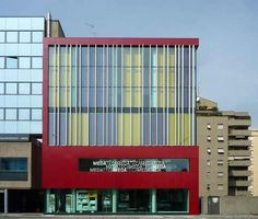 Meda Teca / Italy - loved the simple volume and the vibrant red of this library