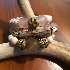Antler tip bracelet stack with cream wooden beads, blush sea glass, and african brass beads
