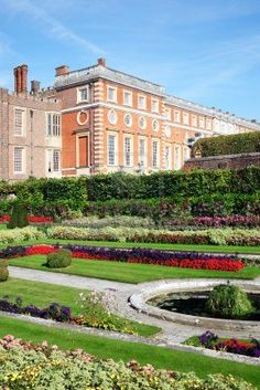 Hampton Court palace in Surrey, England, UK, the home of Henry VIII, with its landscaped Privy Garden in the foreground