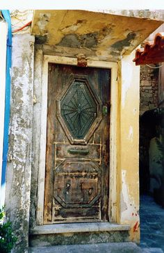Wow! The history behind these doors! If only they could tell us their secrets! Greek doors - Crete