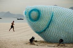 Eco Art in Rio de Janeiro Brazil. A fish sculpture constructed from discarded plastic bottles rises out of the sand at Botafogo beach in Rio de Janeiro, Brazil, on June The city is host to the UN Conference on Sustainable Development, or Land Art, Art Environnemental, Giant Fish, Big Fish, Instalation Art, Drawn Art, Fish Sculpture, Art Sculptures, Modern Sculpture