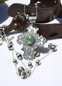 Silver Creations Rosary Style Navajo Sterling Necklace and Manassa Turquoise Cross Pendant! http://www.cowgirlkim.com/silver-creations-rosary-style-navajo-sterling-necklace-and-manassa-turquoise-cross-pendant.html