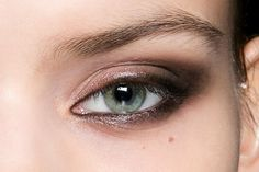 Try this glossy black eye with charcoal-lined waterlines.