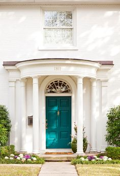 Peacock even has a place on your home's exterior | blue front door | white exterior | design ideas