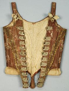 Corset with figural hooks, America or Europe, 18th century. Brown silk satin with polychrome floral brocade, having straps with silk ribbon ties, decorated with metallic gold lace, reticulated silver metal hooks with stag, foliage and unidentified creature to lace over a stomacher, homespun linen lining and hip pads.