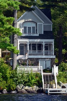 Lake Front Cottage with a Stunning Staircase The original Lake Sunapee cottage was replaced with consideration to the classic Victorian homes in the neighborhood. With houses only eight feet from either side, the design maximizes the allowabl… Lake Cottage, Cottage Homes, Lakeside Cottage, Lakeside Paradise, Romantic Cottage, Future House, My House, Boat House, Story House