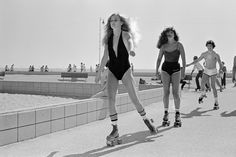 Roller skating on the sea-front walk, Venice Beach, California, 1980