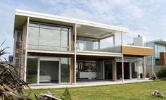 Omaha holiday house by Architecture Smith + Scully: Built in stages, the two parts of this house fit together to form a relaxed space to enjoy the beach lifestyle. Guest House Plans, New Zealand Holidays, Scully, Beach House, Shed, Outdoor Structures, Mansions, Architecture, House Styles
