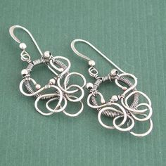 wire wrapped Serenade Earrings by ColettesBoutique, via Flickr