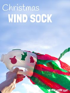 CHRISTMAS WINDSOCKS An easy recycled Christmas craft for kids. A fun Winter activity for kids to enjoy twirling and running with outside.
