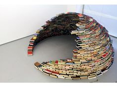 """""""Home"""" is a sculptural installation by Colombian artist Miler Lagos. The piece was constructed at MagnanMetz Gallery in 2011 using carefully stacked books to create a compact dome that is entirely self-supporting."""