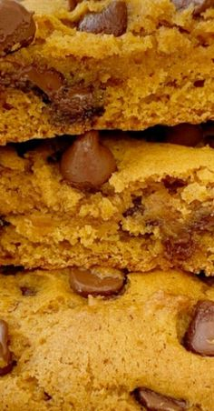 Big pumpkin cookies that are soft-baked, thick, and loaded with milk chocolate chips and pumpkin spices. Best Dessert Recipes, Amazing Recipes, Drink Recipes, Delicious Recipes, Cookie Recipes, Yummy Food, Pumpkin Recipes, Fall Recipes, Holiday Recipes