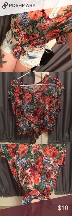 Body Central Shirt ✨Size medium body central shirt. It's super colorful with flowers. It has buttons up the middle and it has a cute little bow at the bottom.✨ Body Central Tops Blouses