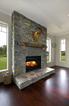 A beautiful stone fireplace featured in a G.J.Gardner home.