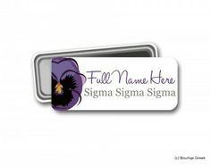 https://boutiquegreek.com/shop/name-tags/trisigma-violet-magnetic-name-tag/