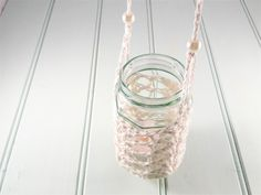 This hanging mason jar candle lamp makes the perfect wedding decoration. It is in a crochet lantern style and casts stunning shadows when lit in the evening