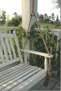 we've been planning on a porch swing addition, & i luv how this one is hung with rope instead of chain!