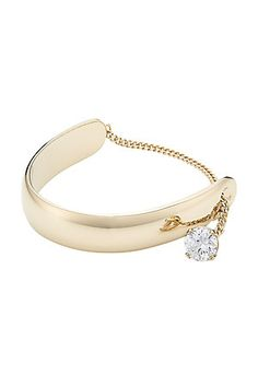Maison Margiela's gold-tone bracelet is detailed with glistening zircon. Slip it on to lend chic sparkle to understate looks #Stylebop