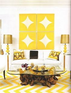 love the wall art (and the yellow chevron rug too)