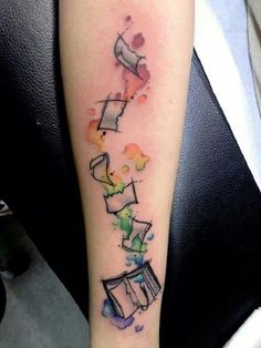 Tearing Book Tattoo. The next tattoo design depicts the tearing book with the great play of colors. You can have this tattoo on your arm too, for amazing creativity.