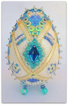 Styrofoam egg decorated with blue crystals,sequins and ribbons.
